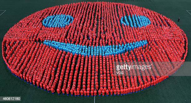 3827 students form a smiley face 52 meters in diameter at Jilin Provincial Experimental School on April 13 2013 in Jilin Jilin Province of China The...