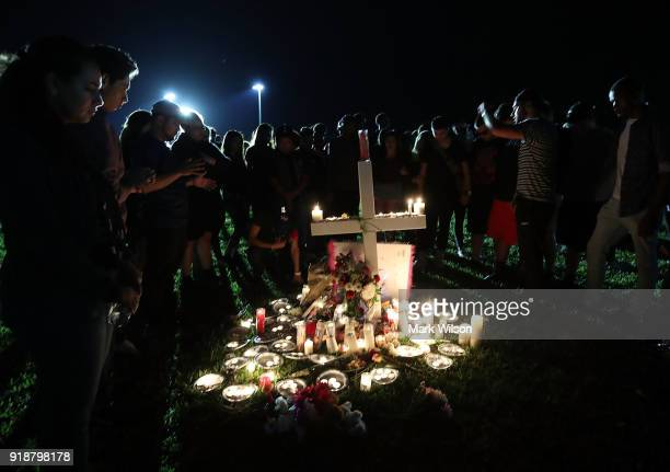 Students friends and family gather to pray during a candlelight vigil for victims of the mass shooting at Marjory Stoneman Douglas High School...
