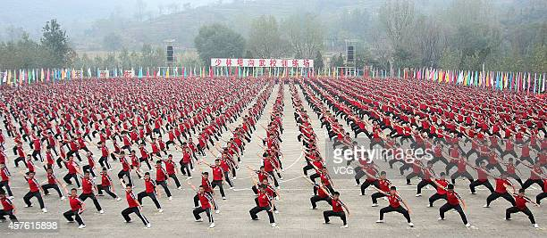 Students from a martial arts school perform kung fu during the welcome ceremony of the Tenth Shaolin International Martial Arts Festival at Shaolin...