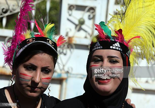 Students from alRafidain private college wear native American costumes to celebrate their graduation as Baghdad universities hold graduation parties...