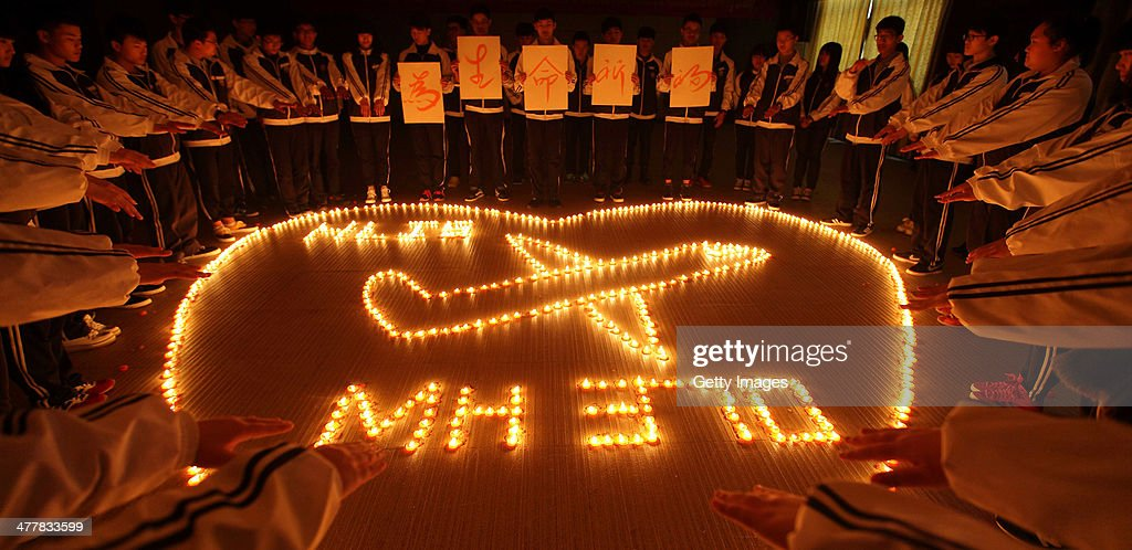 Students Pray For Passengers Onboard MH370 In Zhuji : News Photo