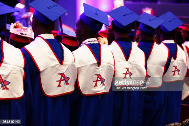 Students from Anacostia High School stand up as their graduation ceremony begins