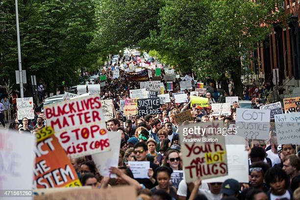 Students from Baltimore colleges and high schools march in protest chanting 'Justice for Freddie Gray' on April 29 2015 in Baltimore Maryland...