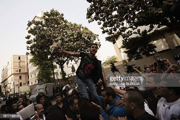 Students from Cairo University demonstrate outside the Egyptian Prime Minister's office demanding the release of students arrested in previous...