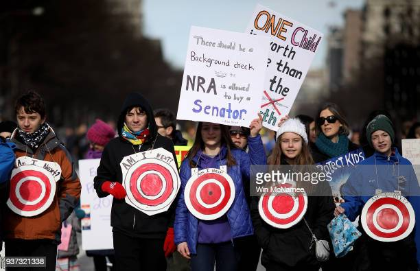 Students from Centreville Virginia wear targets on their chests as they arrive for the March for Our Lives rally March 24 2018 in Washington DC...
