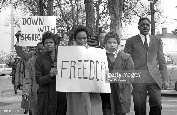Students from Claflin University and State College demonstrate during a antisegregation march along a street in downtown Orangeburg South Carolina...