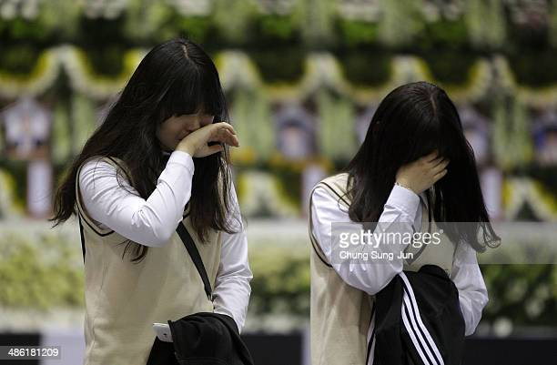 Students from Danwon high school weep after tribute at a group memorial altar for victims of sunken passengers ship at the Ansan Olympic Memorial...