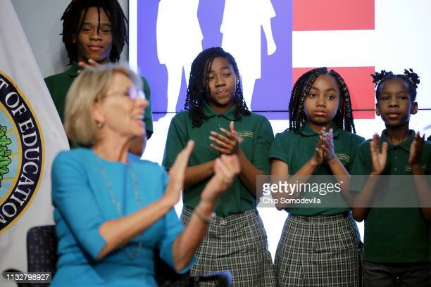 Students from Digital Pioneers Academy stand behind US Education Secretary Betsy DeVos during an event to discuss her proposal for Education Freedom...