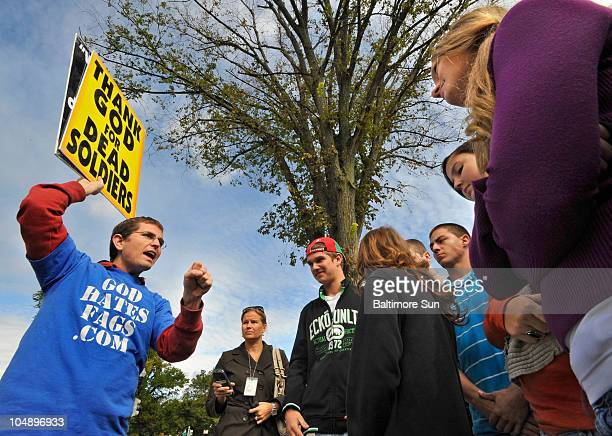 Students from Eastern Mennonite High School in Harrisonburg, Virginia, right, engage Jacob Phelps, grandson of Fred Phelps, in a heated exchange...