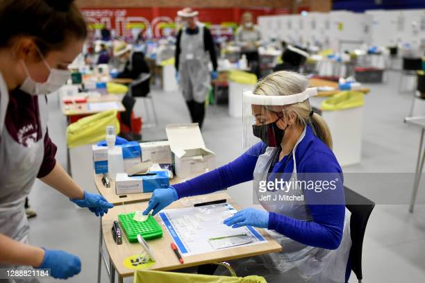 Students from Edinburgh University conduct asymptomatic testing using lateral flow antigen at a test centre which is also open to students in...
