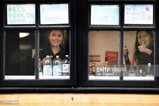 Students from Glasgow University look out of the windows of the student accommodation at Murano Street student village on September 28, 2020 in...