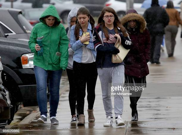 Students from Great Mills High School walk to meet their parents at Leonardtown High School following a school shooting at Great Mills High School...
