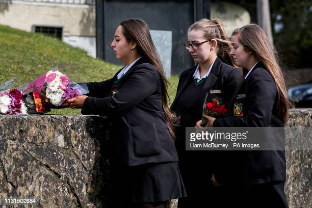 Students from Holy Trinity College leave floral tributes outside The Greenvale Hotel in Cookstown Co Tyrone in Northern Ireland following the deaths...