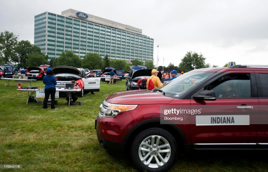 Students from Indiana drive their vehicle to the road test area after finishing repairs at the National Finals of the Annual Ford/AAA Student Auto Skills Competition at the Ford Motor Co. World Headquarters in Dearborn, Michigan, U.S., on Tuesday, June 11, 2013. Job openings in the U.S. fell in April, showing companies were waiting to assess the effects of higher taxes and reduced government spending before committing to bigger staff increases. Photographer: Ty Wright/Bloomberg via Getty Images