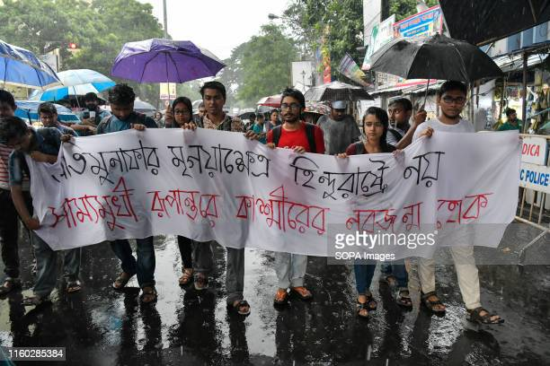 Students from Jadavpur University march with a banner during a protest rally against scrapping of Article 370 in Kolkata The article 370 of the...