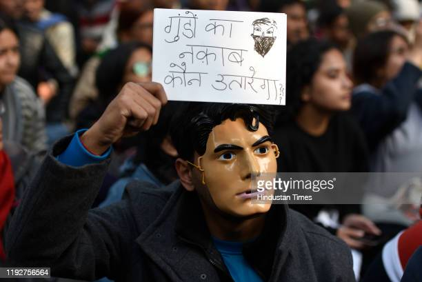 Students from Jawaharlal Nehru University hold placards and raise slogans during a protest march from Mandi House to HRD Ministry, demanding the...