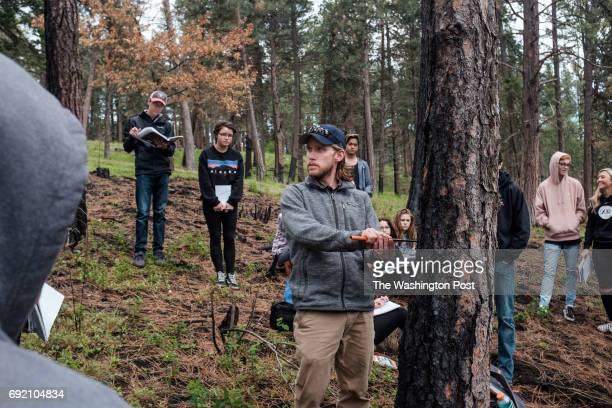 Students from Lake City High School visit Farragut State Park in Idaho with their teacher Jamie Esler to learn about the effects that trees have on...