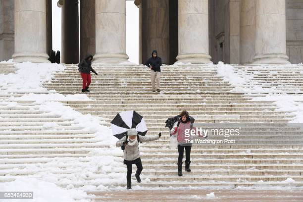 Students from Marietta High School in Marietta GA visit the Thomas Jefferson Memorial during a nor'easter that blanketed the area with snow and sleet...