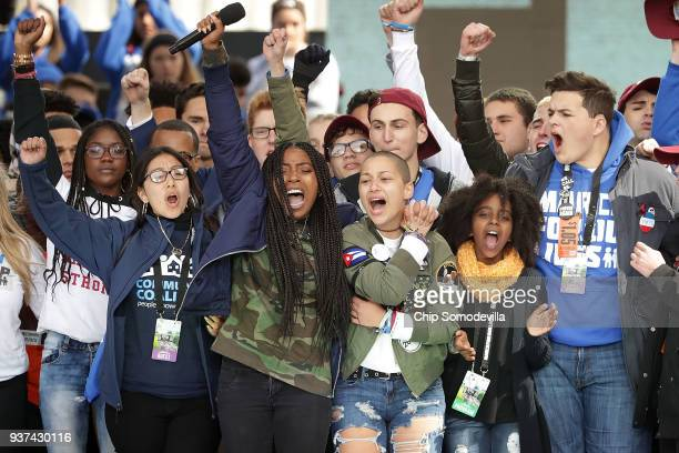 Students from Marjory Stoneman Douglas High School including Emma Gonzalez stand together on stage with other young victims of gun violence at the...
