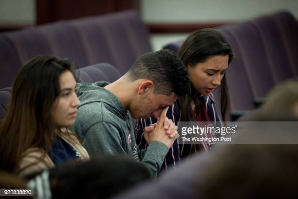Students from Marjory Stoneman Douglas High School pray before meeting with senators in Senate Building in the Florida State Capitol a week after a...