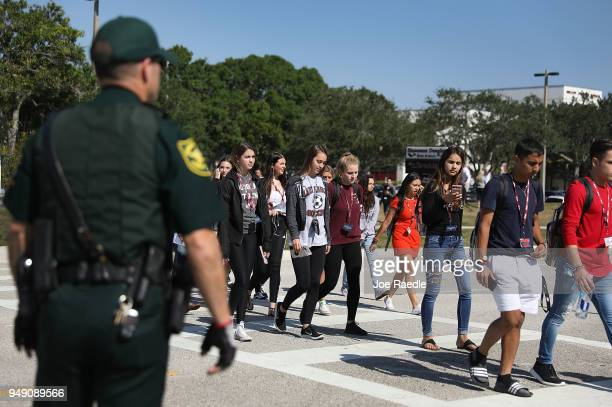 Students from Marjory Stoneman Douglas High School where 17 classmates and teachers were killed during a mass shooting join the National School...