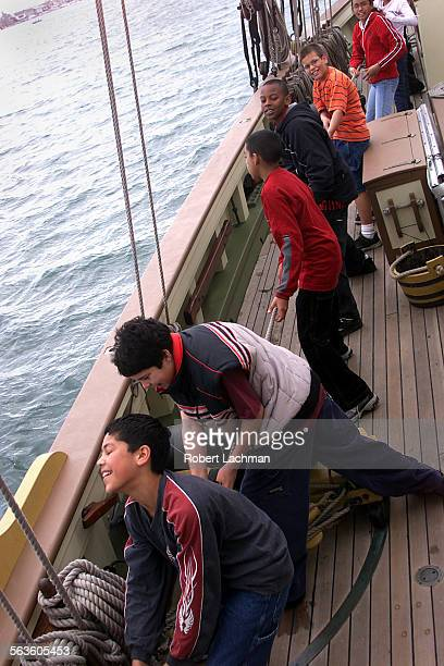 Students from Mary Fay Pendleton school pull together on the deck of the schooner LYNX to hoist a sail The hands–on learning program was hosted by...