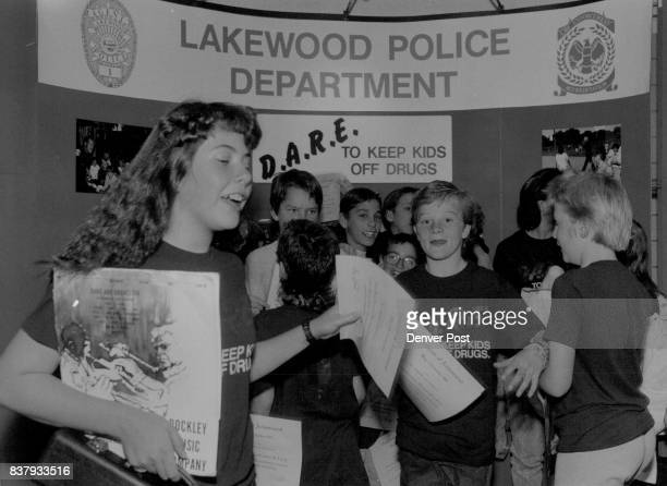 Students from Moholm Elementary school hang around the display board put up by the Lakewood Police Dept The display had p materiel to do with the...