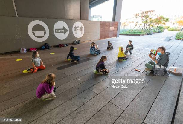 Students from PS 11 elementary school in Chelsea participate in outdoor learning on The High Line park on October 21 2020 in New York City The after...