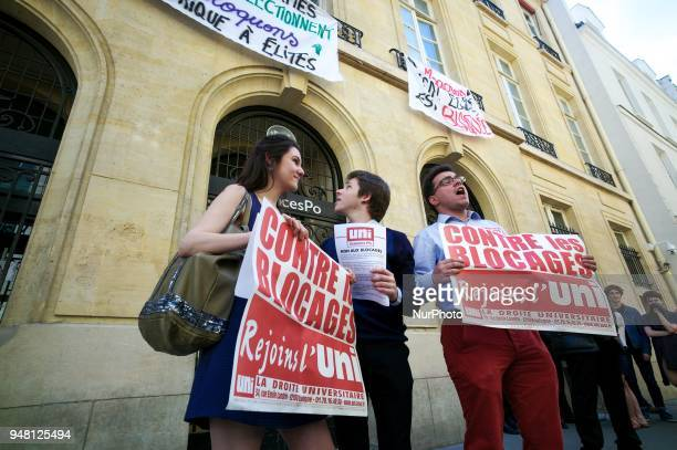 Students from rightwing party hold signs reading against the blockings as other students block the entrance of Sciences Po university on April 18...