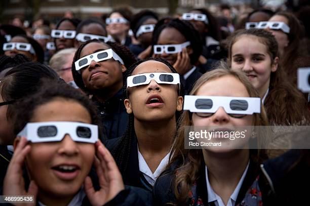 Students from Saint Ursula's Covent Secondary School in Greenwich pose for a photograph wearing protective glasses at the Royal Observatory Greenwich...