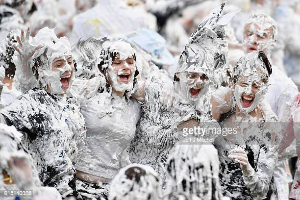 Students from St Andrew's University indulge in a tradition of covering themselves with foam to honour the 'academic family' on October 17 in St...