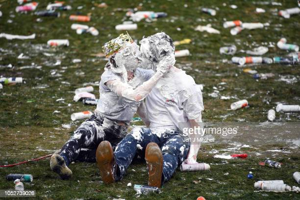 Students from St Andrews University many in fancy dress indulge in a tradition of covering themselves with foam to honour the 'academic family' on...