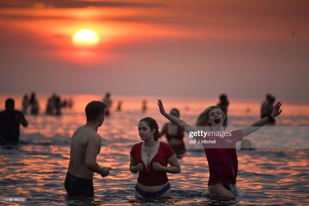 St. Andrews Students Take Annual May Day Dip : News Photo