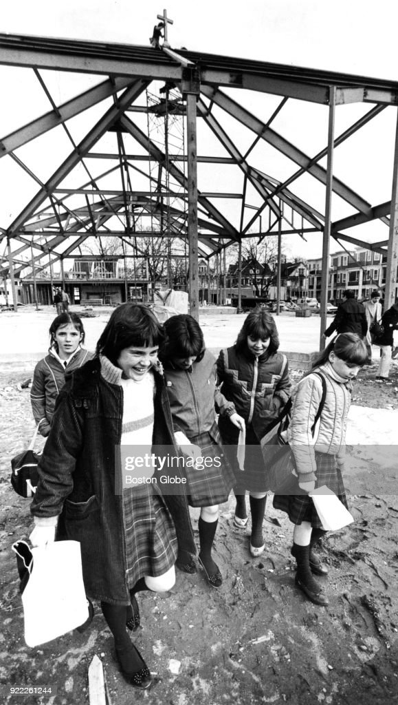Students from St. William's School leave the grounds following a topping-off ceremony for the new St. William's Church building in the Dorchester neighborhood of Boston on March 4, 1983. The building replaces the church destroyed by a fire in September 1980.