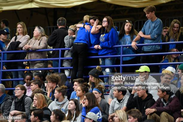 Students from STEM school hug during a vigil for Kendrick Castillo in the gymnasium at Highlands Ranch High School on May 8, 2019 in Highlands Ranch,...