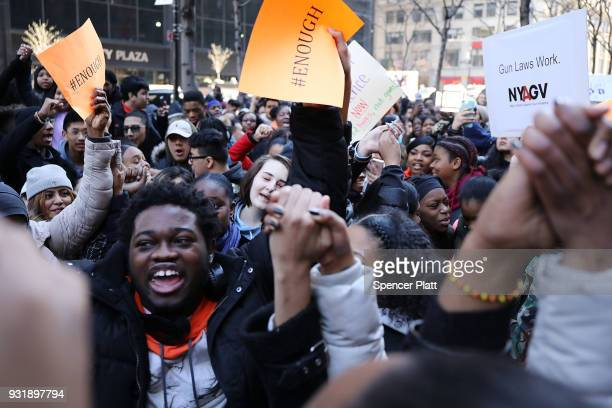 Students from surrounding schools gather at Zuccotti Park in lower Manhattan to mark one month since the high school shooting in Parkland Florida and...