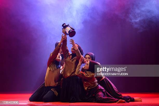 Students from Syiah Kuala University's Faculty of Arts and Design perform a contemporary dance as part of their final examinations in Banda Aceh on...