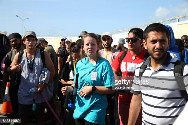 Students from the American University of the Caribbean School of Medicine AUC wait to be evacuated aboard a Puerto Rico National Guard C130 plane at...
