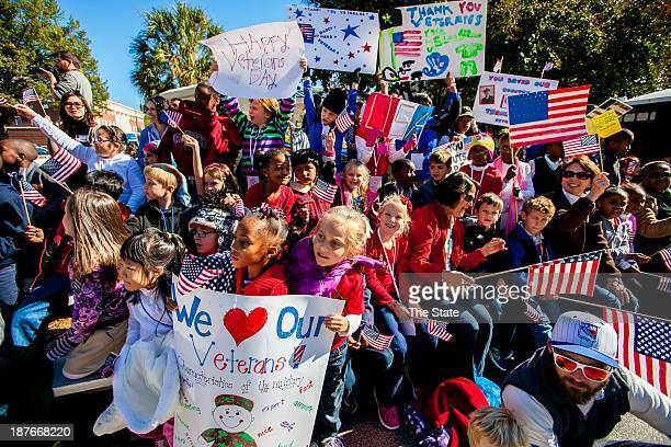 Students from the Center For Knowledge shout Thank You in unison to passing members of the military during the 35th Annual Veterans Day Parade in...