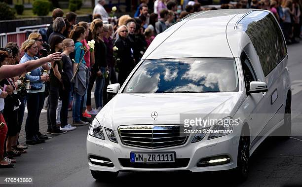 Students from the JosephKoenigGymnasium high school watch as hearses carrying the remains of 16 of their fellow students and two teachers who were...