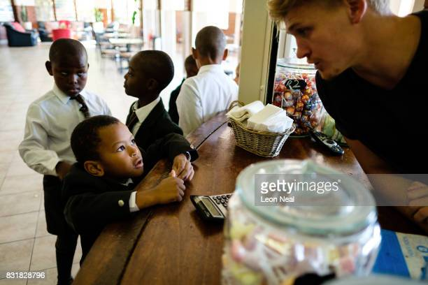 Students from the King Edward VII school queue for sweets and snacks at the tuck shop on March 29 2017 in Johannesburg South Africa Those born since...