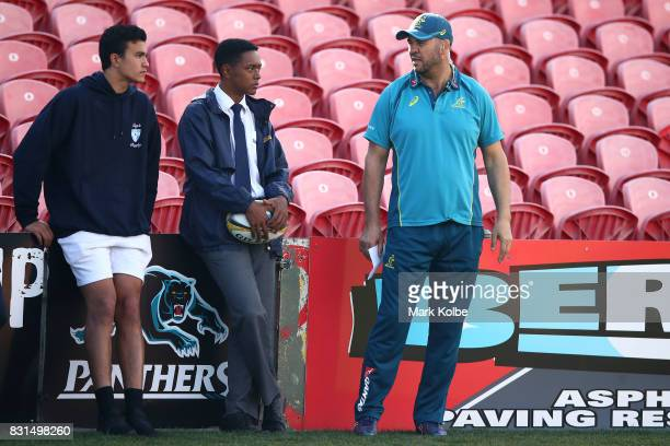 Students from the Kings School listen as Wallabies head coach Michael Cheika speaks to them during an Australian Wallabies training session at Pepper...