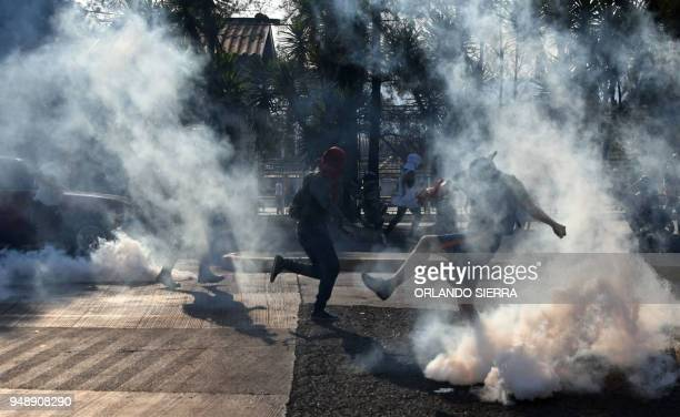 TOPSHOT Students from the National Autonomous University of Honduras clash with riot police in Tegucigalpa during a protest called after a student...