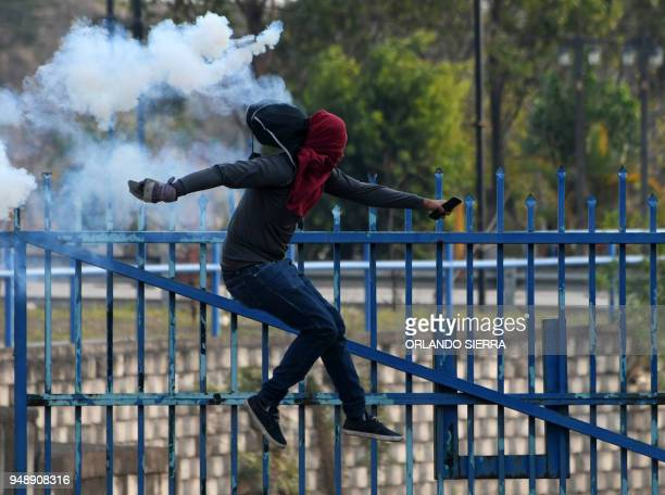 Students from the National Autonomous University of Honduras clash with riot police in Tegucigalpa during a protest called after a student was...