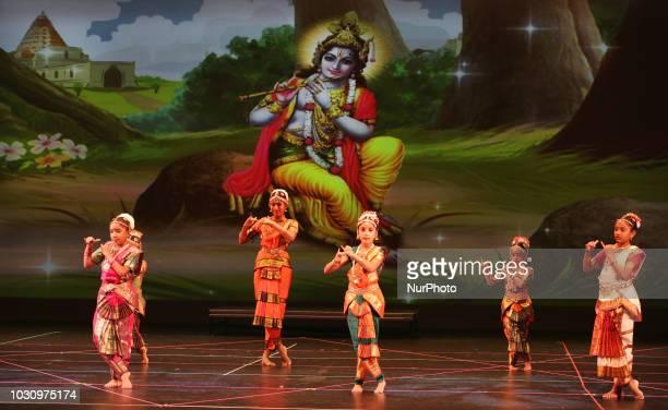 Students from the Nritya Kala Mandir School of Indian Classical Dance perform a Bharatnatyam dance honouring Lord Krishna during the Nrityotsava...