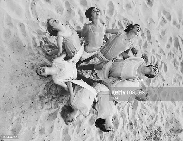 Students from the Preston School of Dancing form a circular group while rehearsing in Grecian costume at the Cavalier Beach Club Virginia circa 1935