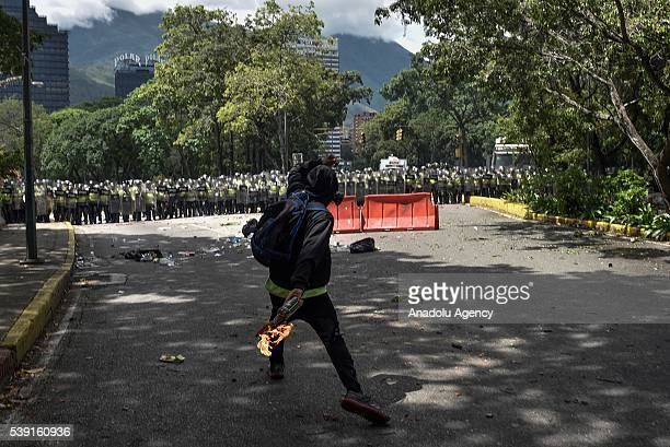 Students from the public Central University of Venezuela clash with Venezuelan police during a protest demanding response on the recall referendum of...