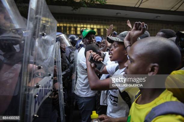 Students from the South African Ruling party African National Congress face South African police ahead of the annual State Of The Nation Address on...