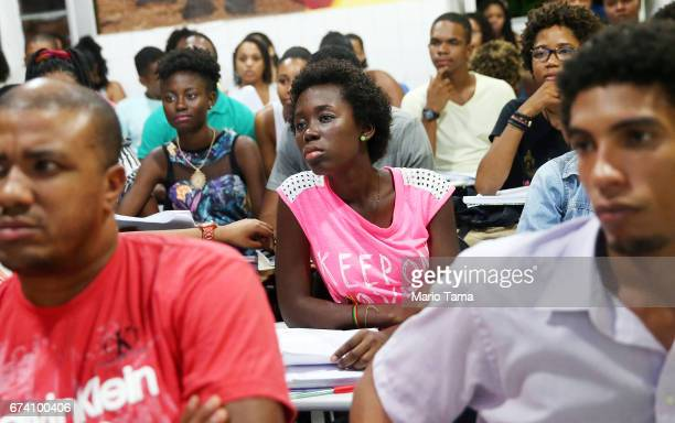 Students from the Steve Biko Institute gather during a lecture on April 16 2015 in Salvador Brazil The Steve Biko Institute offers a free yearlong...