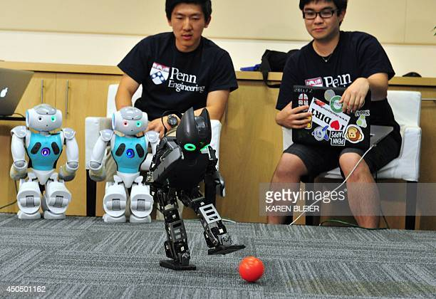 Students from the the University of Pennsylvania General Robotics Automation Sensing and Perception Laboratory observe as their robots play soccer...